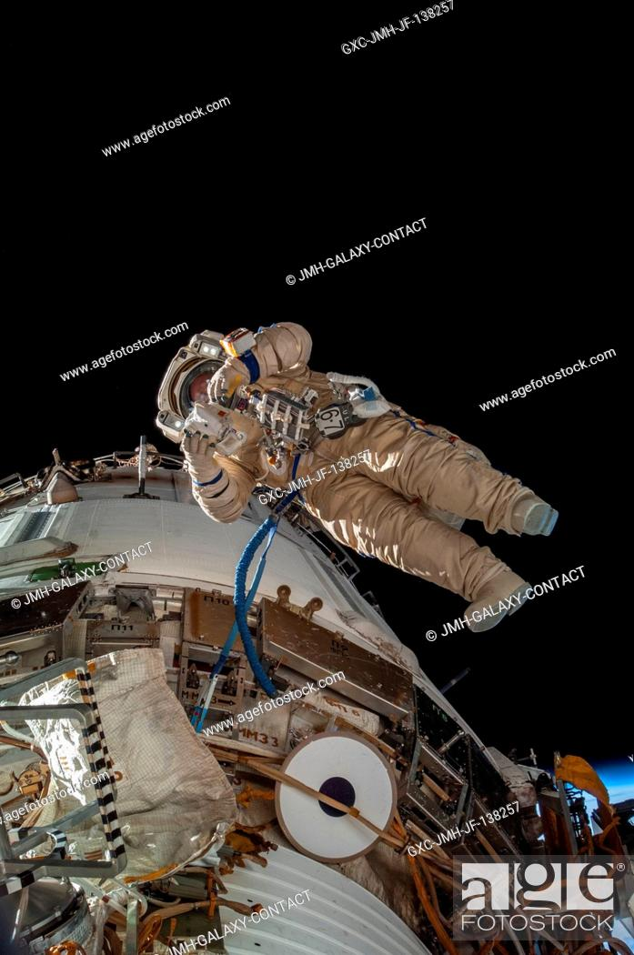 Stock Photo: Russian cosmonaut Sergey Ryazanskiy, Expedition 38 flight engineer, attired in a Russian Orlan spacesuit, participates in a session of extravehicular activity.