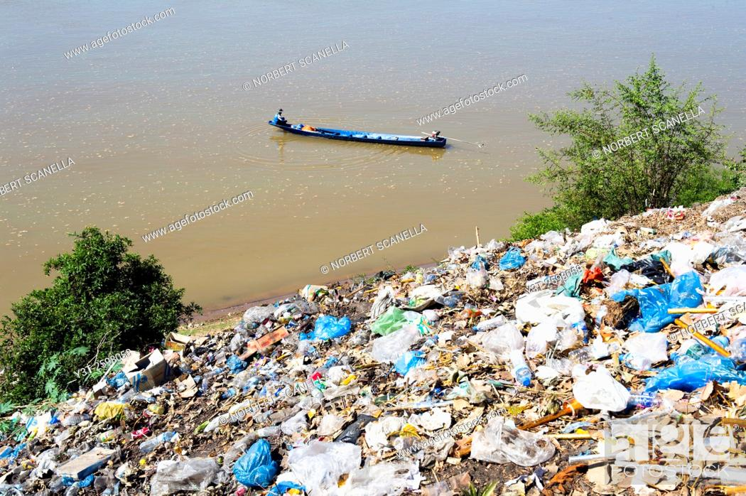 Stock Photo: Asia. South-East Asia. Laos. Province of Khammouane. Thakhek. Pollution on the banks of the Mekong.