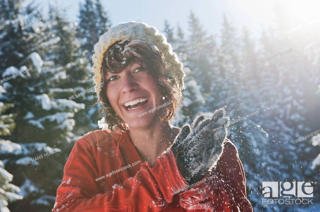 Stock Photo: Austria, Salzburg Country, Flachau, Young woman having fun in snow.