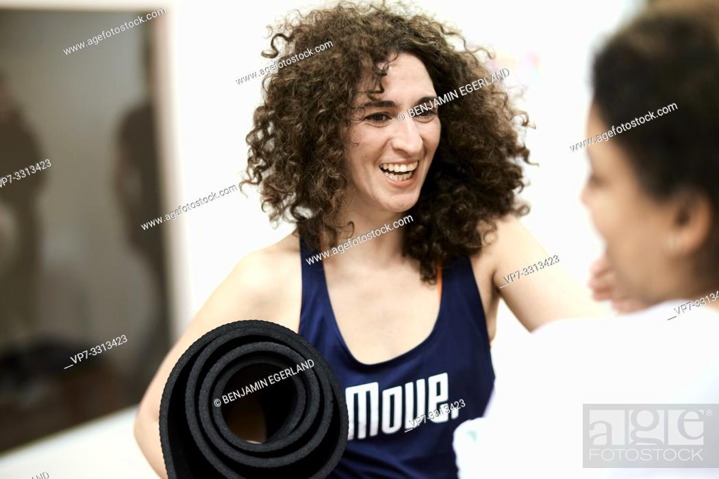 Stock Photo: happy sporty women laughing in fitness studio.