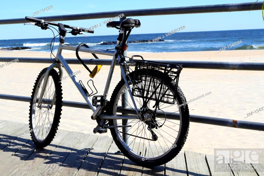 Stock Photo: An old bicycle tied up on the boardwalk in Asbury Park, New Jersey, USA.