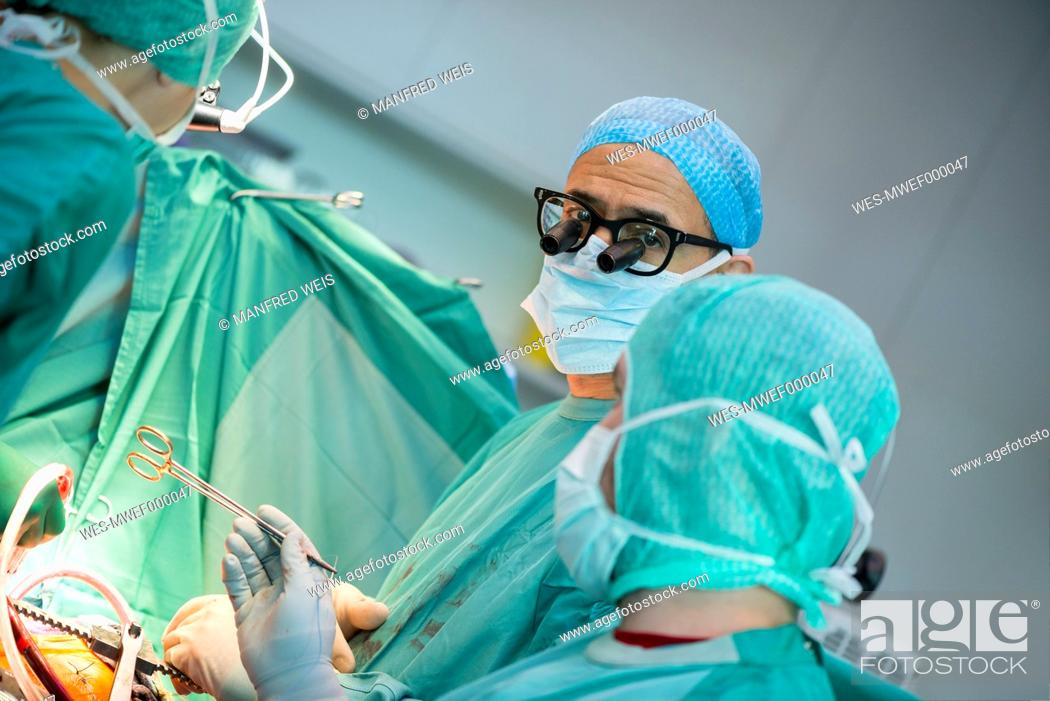 Stock Photo: Heart surgeons during a heart operation.