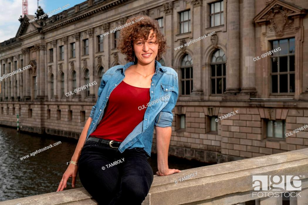 Stock Photo: Female student exploring city, Berlin, Germany.