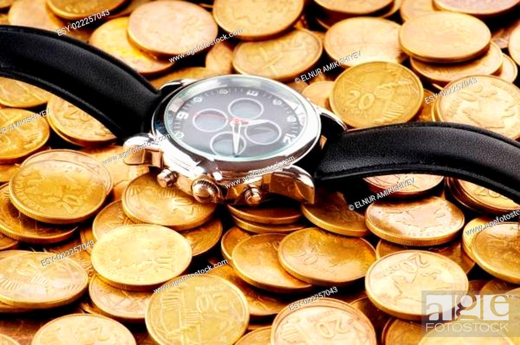 Stock Photo: Time is money concept with watch and coins.