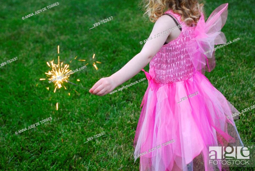 Stock Photo: Little girl with sparkler.
