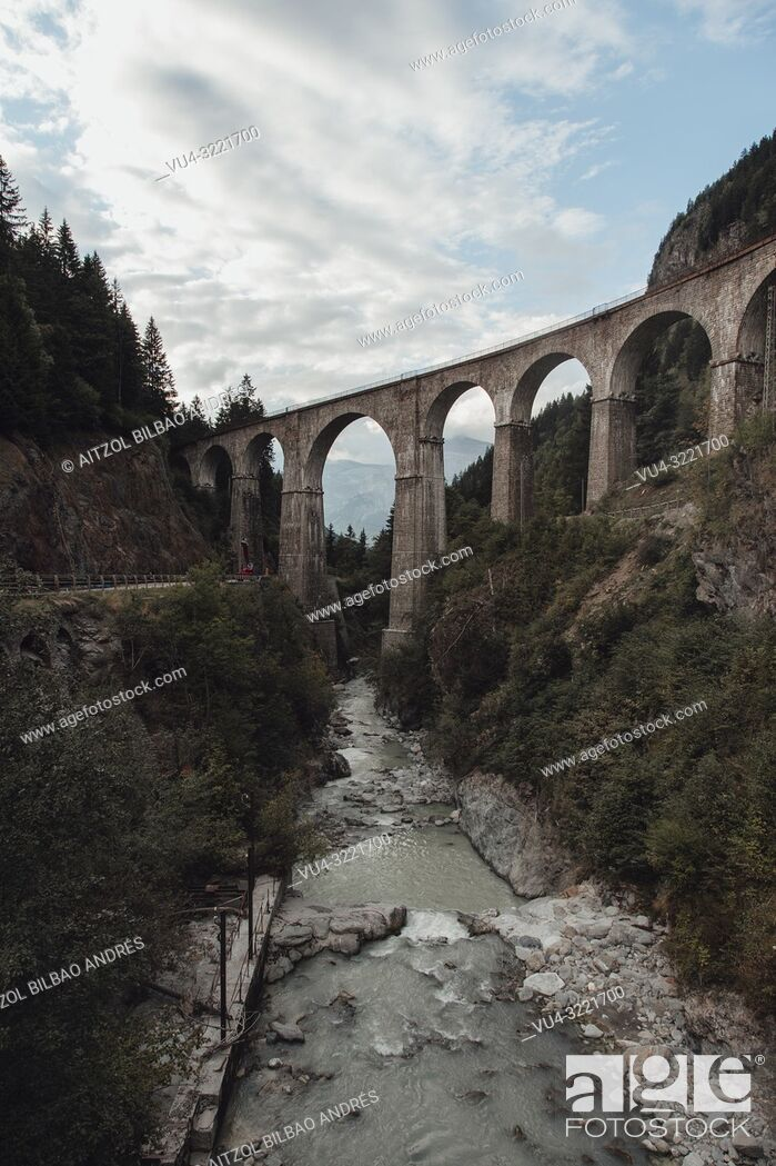 Stock Photo: This bridge is near Chamonix Mont Blanc, the river comes from the ice of the mountains so it has that grey color.