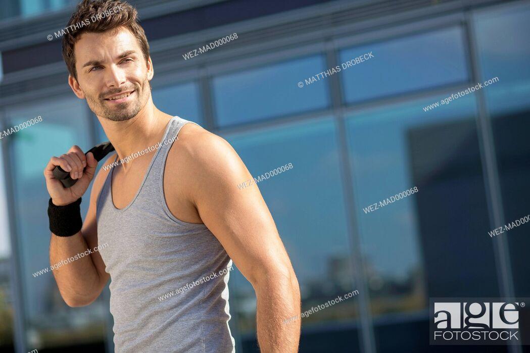 Stock Photo: Portrait of smiling sportsman.