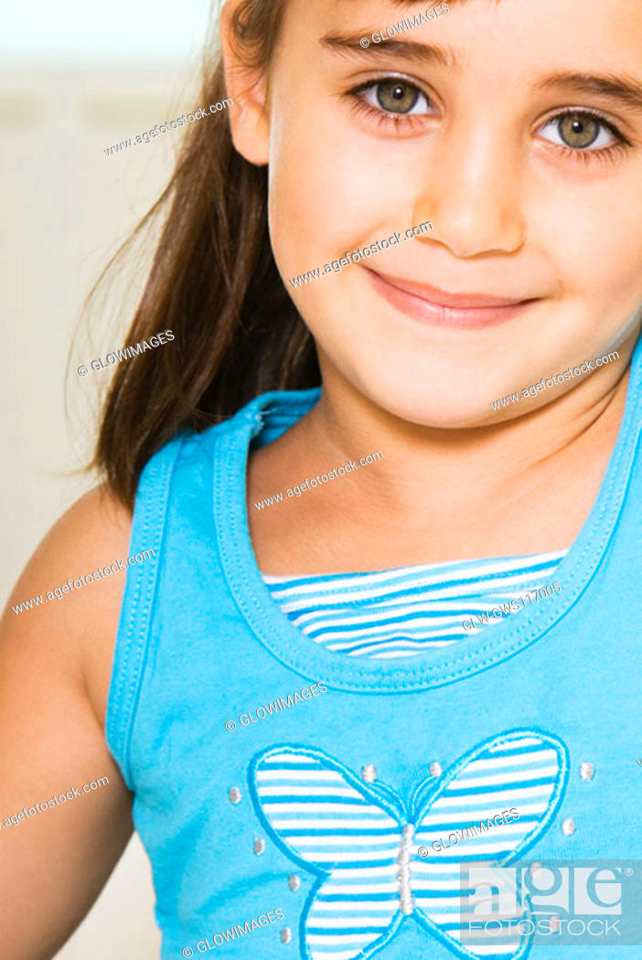 Stock Photo: Portrait of a girl smiling.