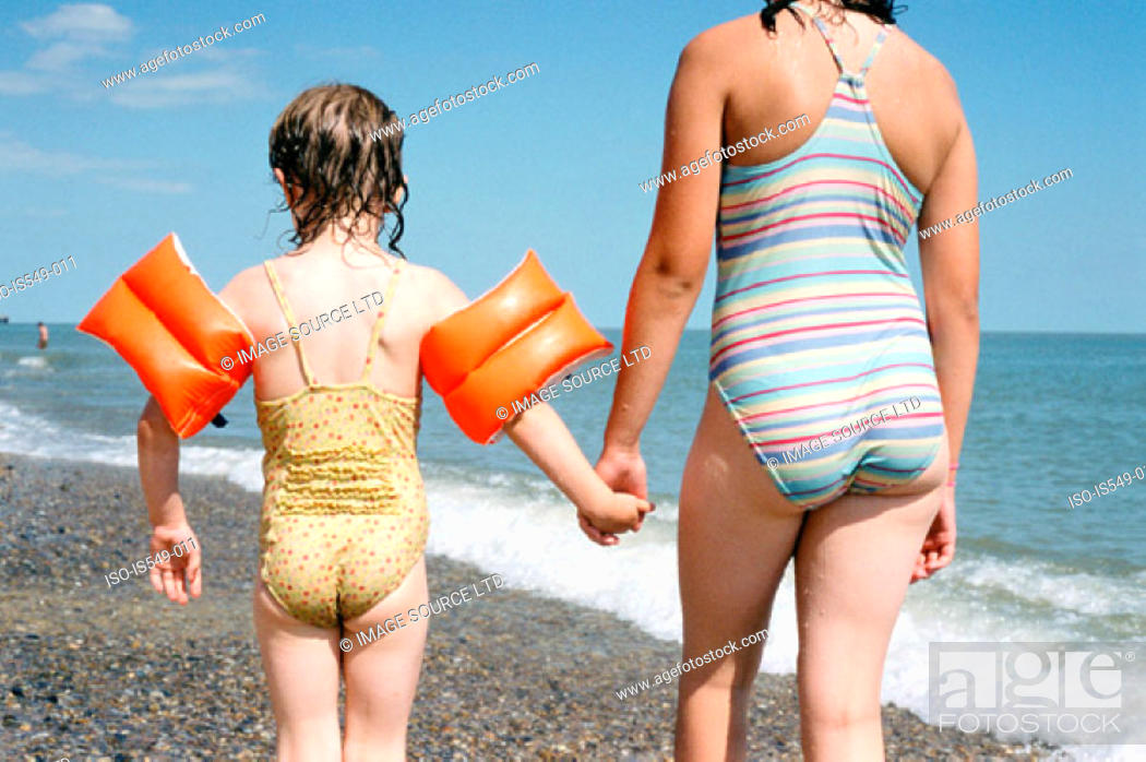 Stock Photo: Girls on the beach.