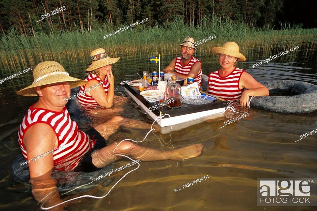 Stock Photo: Two couples dine in water. Lake Vattern. Sweden.