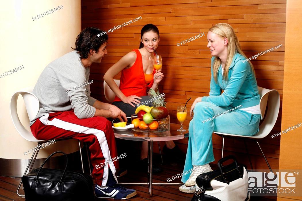 Stock Photo: Pilates students at fitness club juice bar.