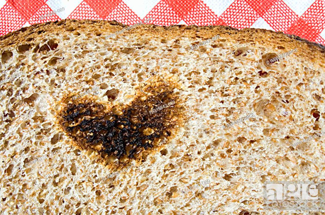 Stock Photo: Heart shape burnt on toast.
