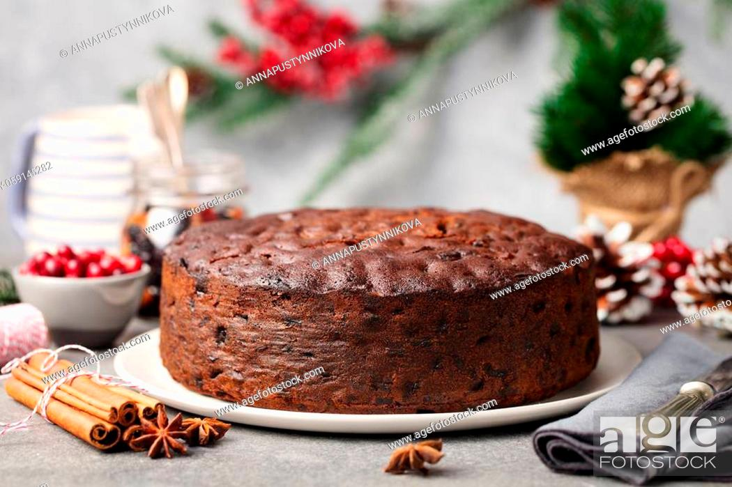 Stock Photo: Christmas fruit cake, pudding on white plate. Copy space. Close up.
