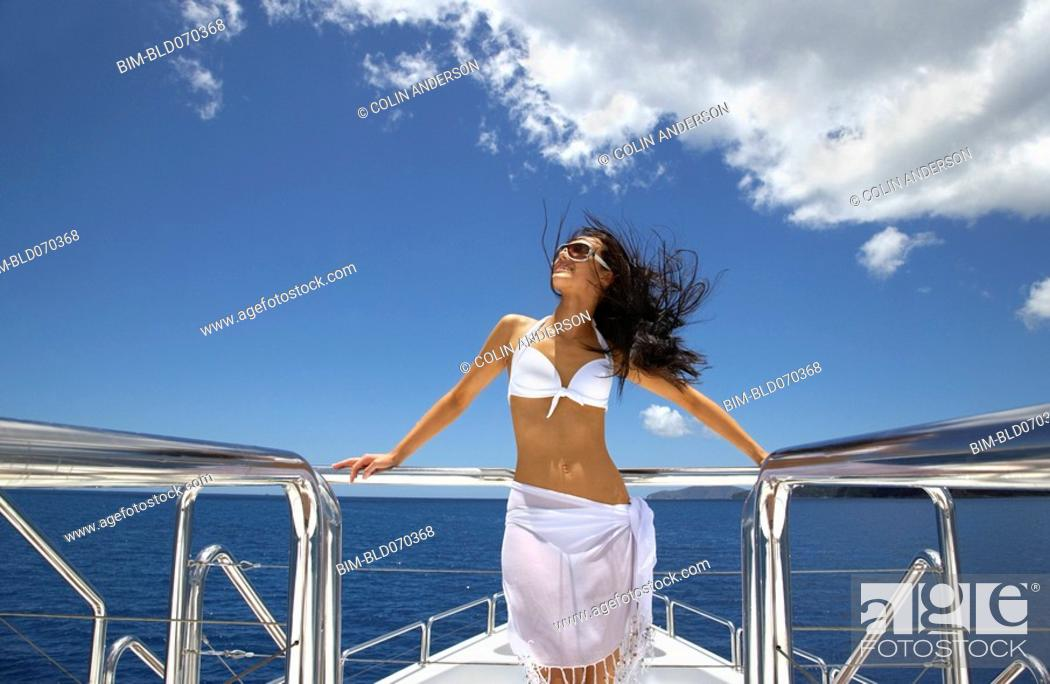 Stock Photo: Pacific Islander woman standing on yacht.