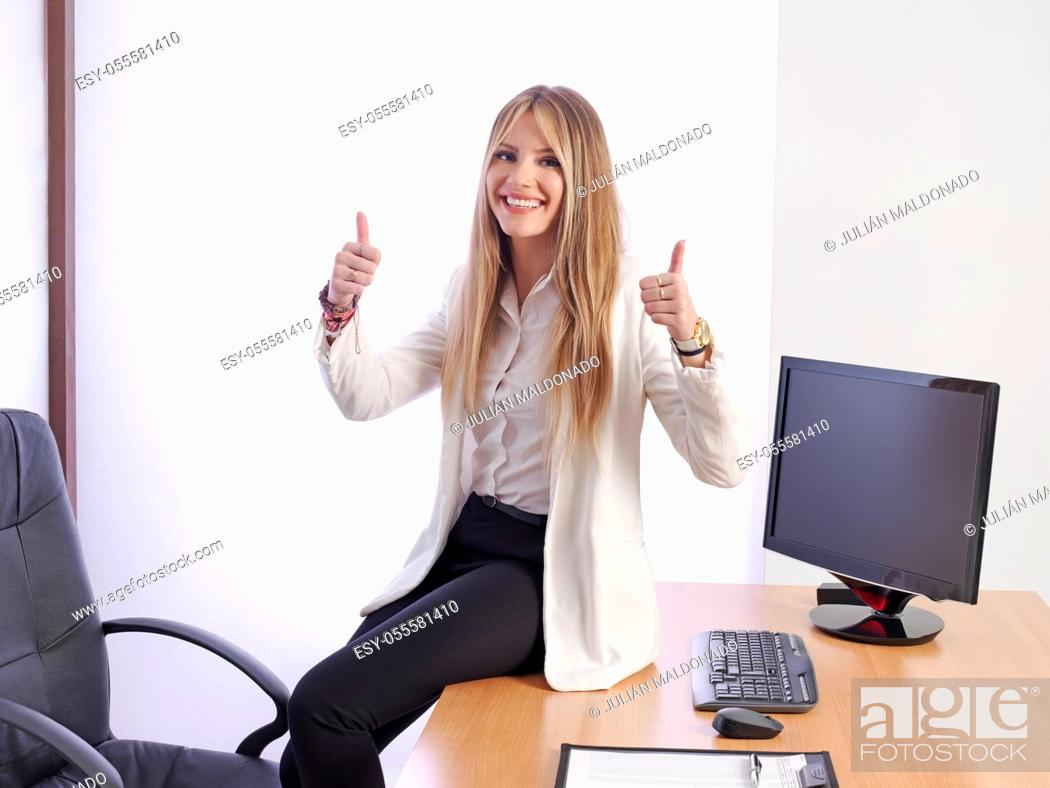 Stock Photo: Young business woman smiling and with positive attitude.