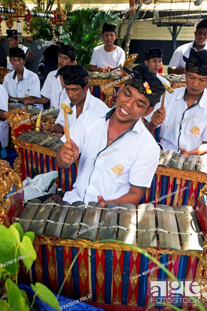 Stock Photo: Indonesia, Bali, Jimbaran, gamelan orchestra playing during a ceremony in a private house.