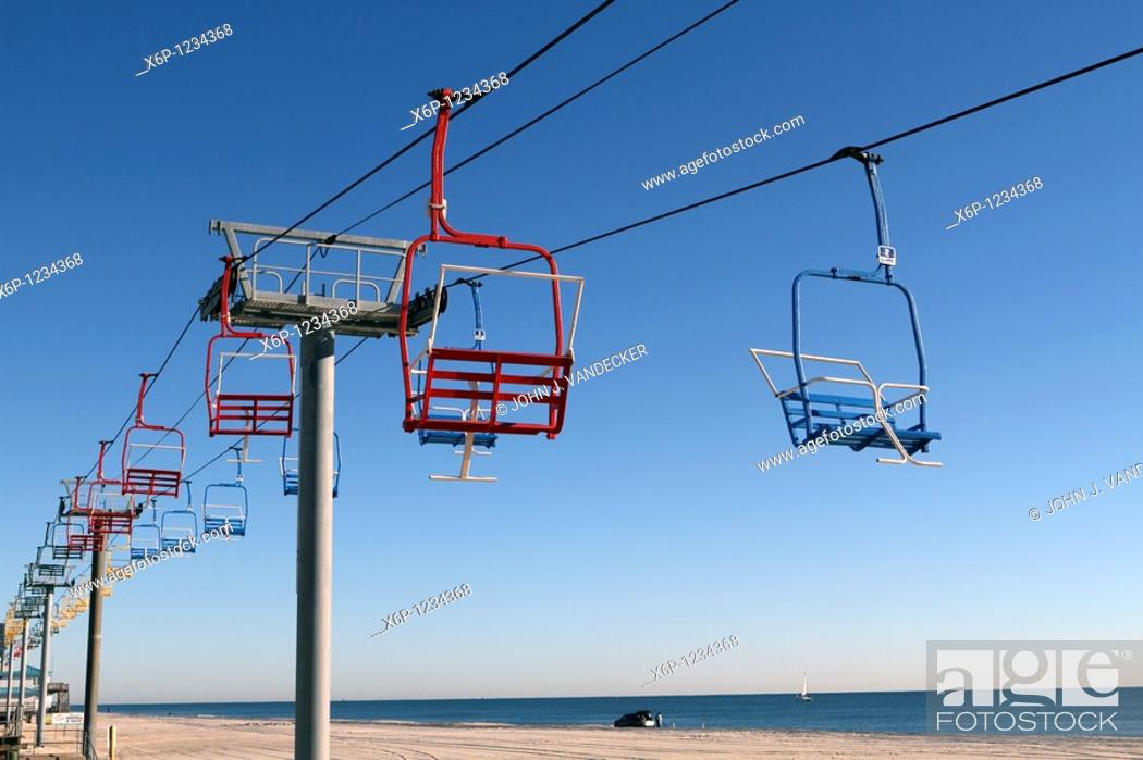 Stock Photo: Seaside Heights New Jersey USA chair lift ride on the beach running along the boardwalk.
