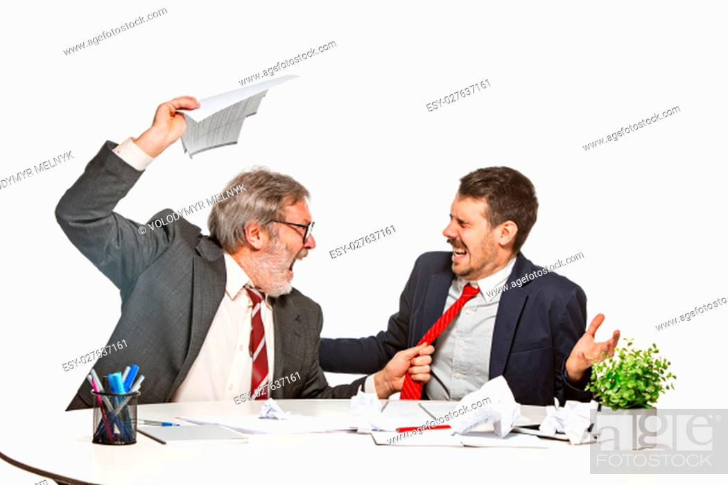 Stock Photo: The two colleagues working together at office on white studio background. concept of conflict and rage.