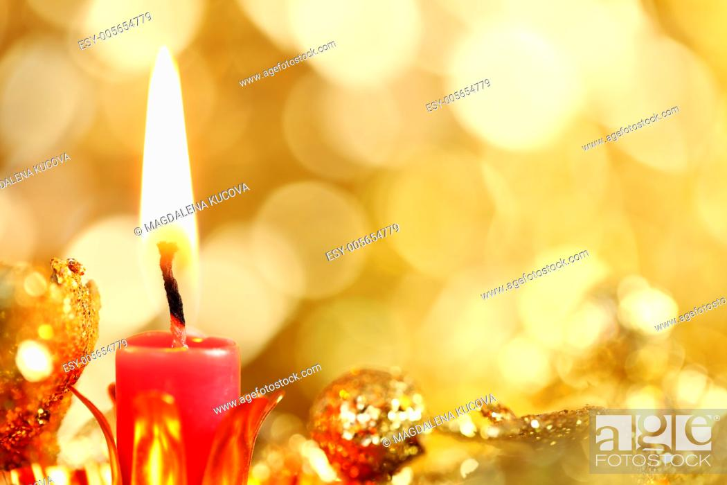 Photo de stock: Candle and defocused abstract background.