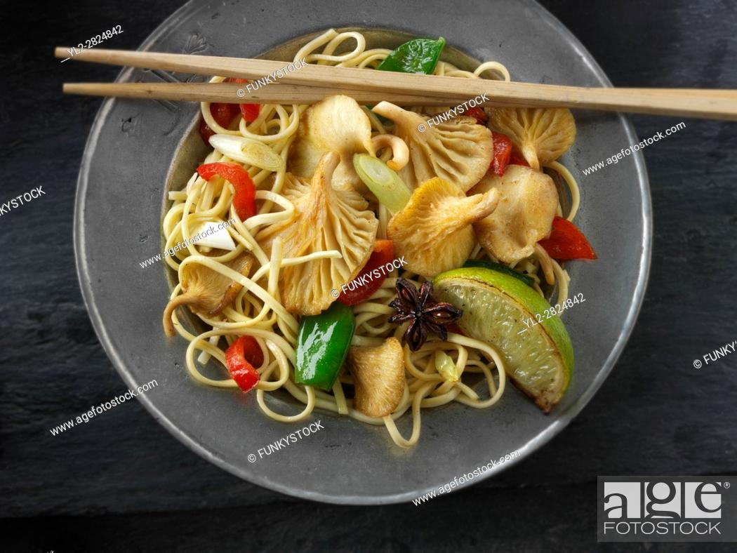 Stock Photo: Yellow Oyster mushroom stir fry with noodles, mange tout, red pepper, spring onions and start anise.