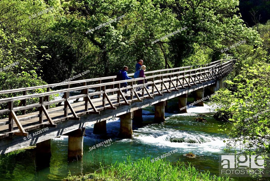 Stock Photo: Two hikers on a bridge near Roski Slap, Krka Waterfalls, Krka National Park, Croatia.