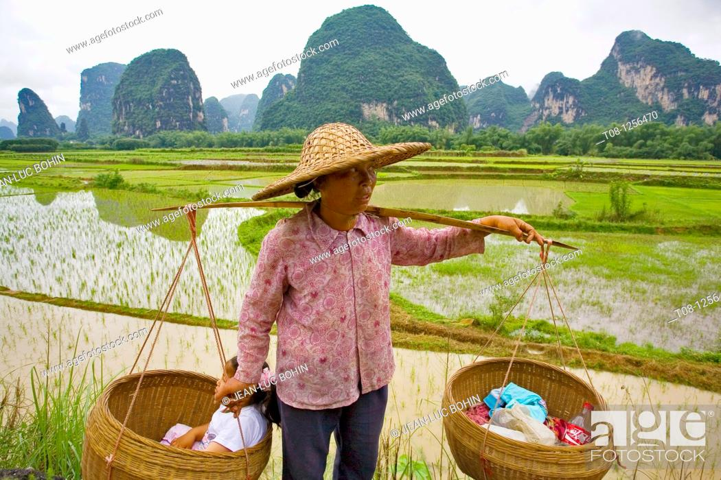 Stock Photo: China, , Yangshuo, countryside and rice fields: farmer.