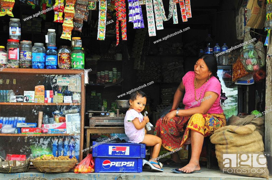 Stock Photo: The woman with daughter keeping the shop.