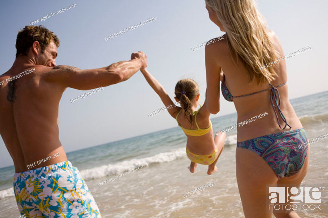 Stock Photo: Family on beach playing together.