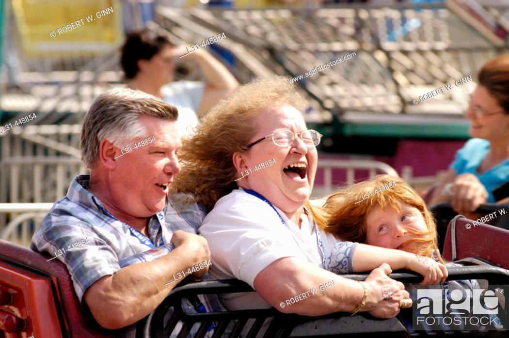 Stock Photo: People on local carnival rides for fun during summer vacations.
