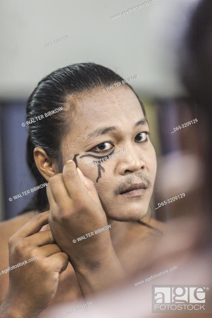Stock Photo: Cambodia, Battambang, Phar Ponleu Selpak, arts and circus school, young acrobat applying makeup before circus performance, ER.