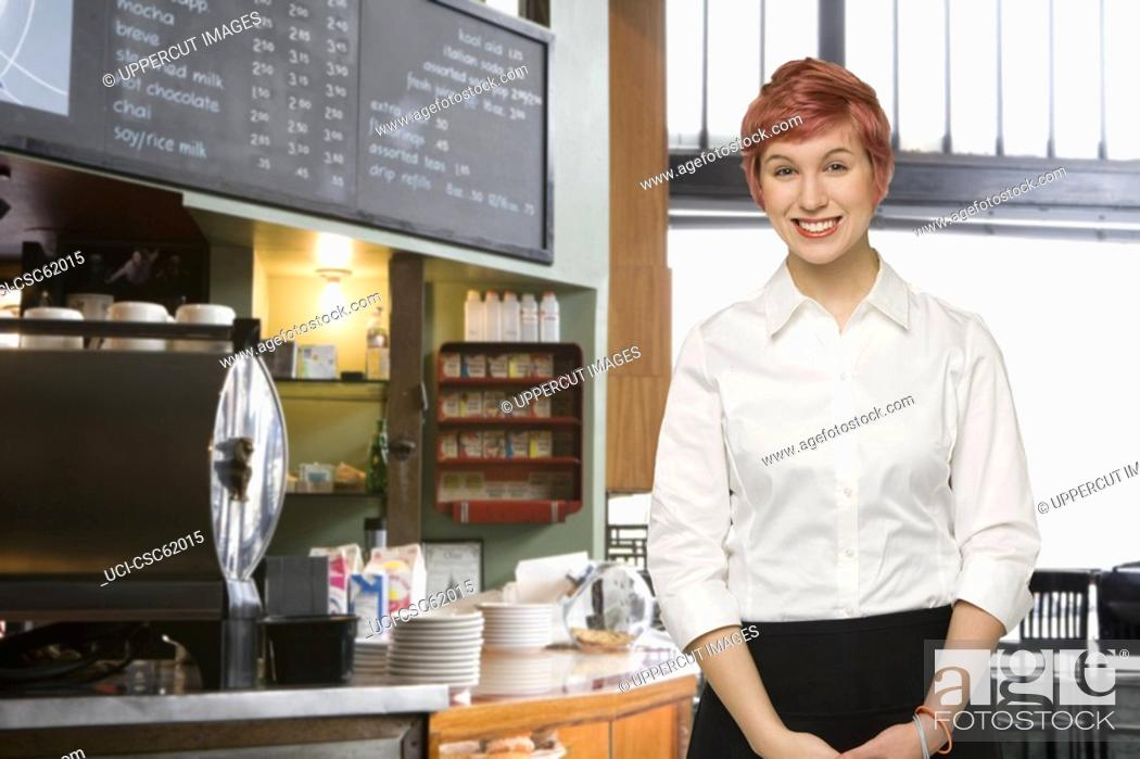 Stock Photo: Female server at coffee shop.