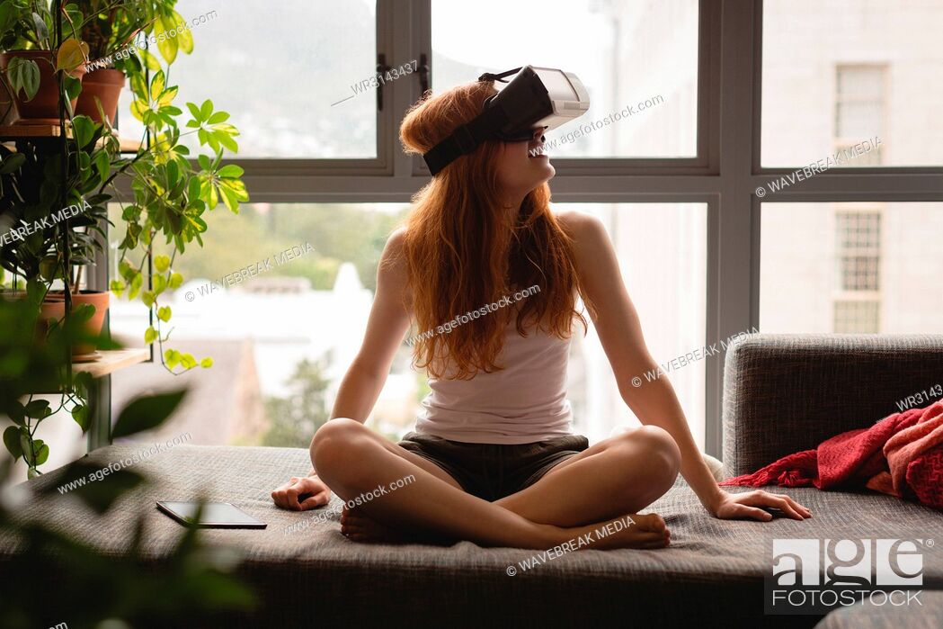 Stock Photo: Woman using virtual reality headset.
