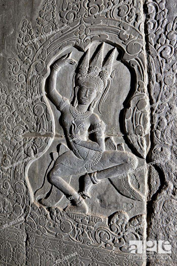Stock Photo: Bas-relief of a dancing Apsara (celestial dancer) at Angkor Wat temple complex. Angkor Archaeological Park, Siem Reap Province, Cambodia.