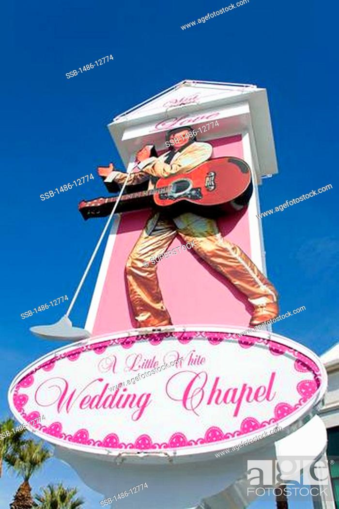 Little White Wedding Chapel.Low Angle View Of A Signboard Of A Wedding Chapel The Little White