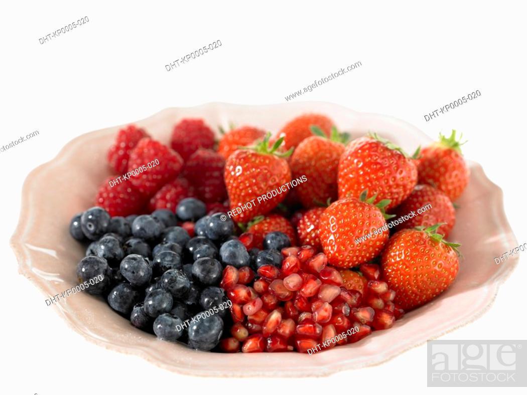 Stock Photo: Strawberries raspberries Blueberries and Pomegranate Seeds.