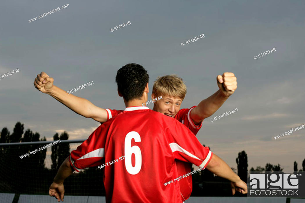 Stock Photo: Soccer players jubilating.