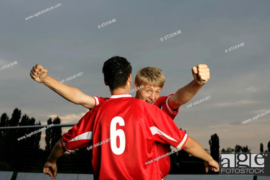 Stock Photo: Soccer players jubilating.
