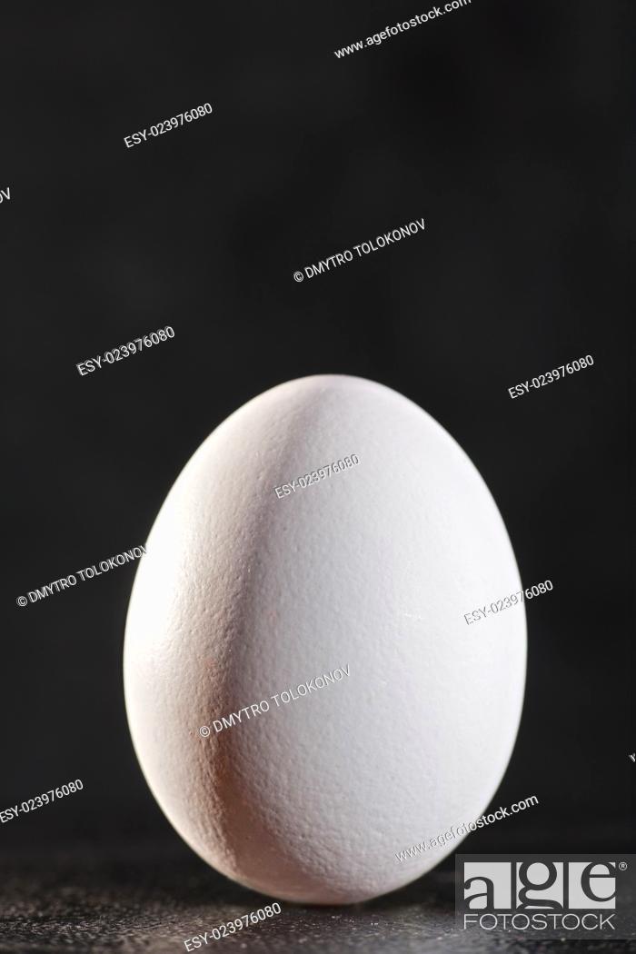 Stock Photo: White egg against dark backgrounds.