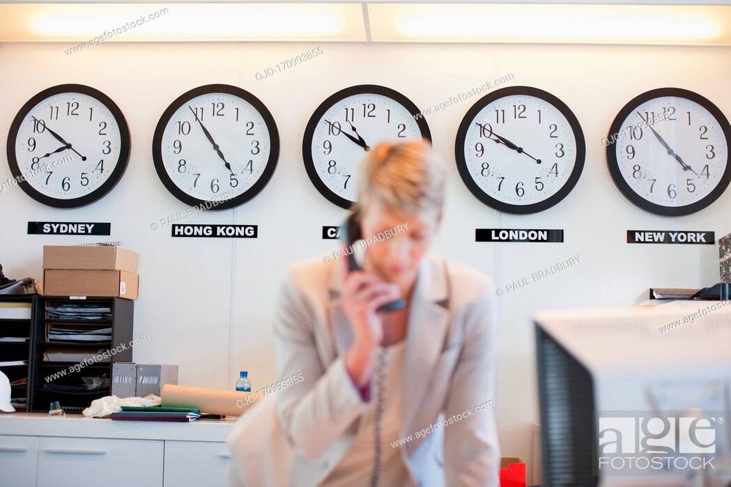 Stock Photo: Businesswoman talking on phone in office.