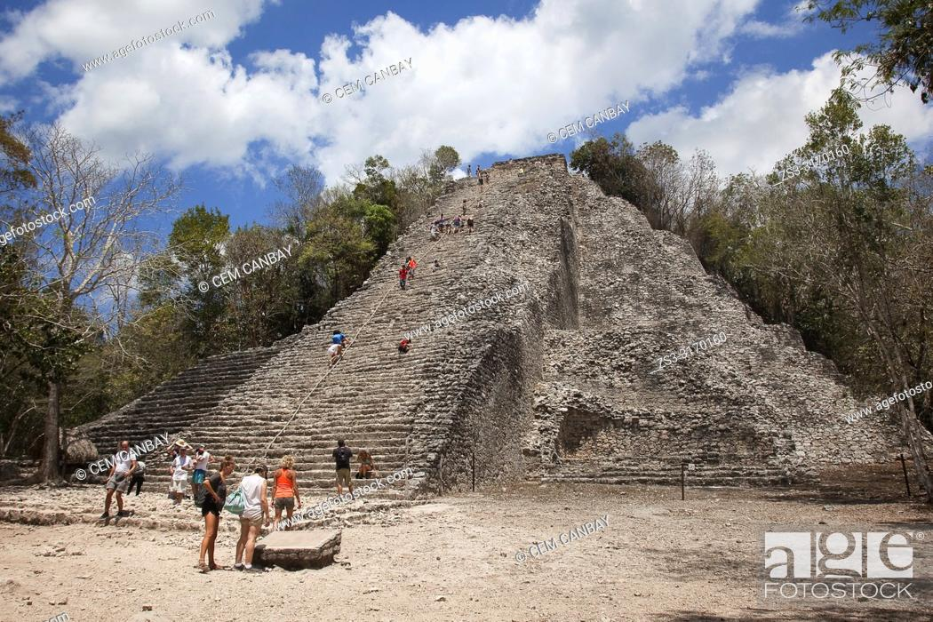 Stock Photo: Tourists climbing up the Nohoch Mul Pyramid at the Prehispanic Mayan city of Coba Archaeological Site, Quintana Roo Province, Mexico, Central America.