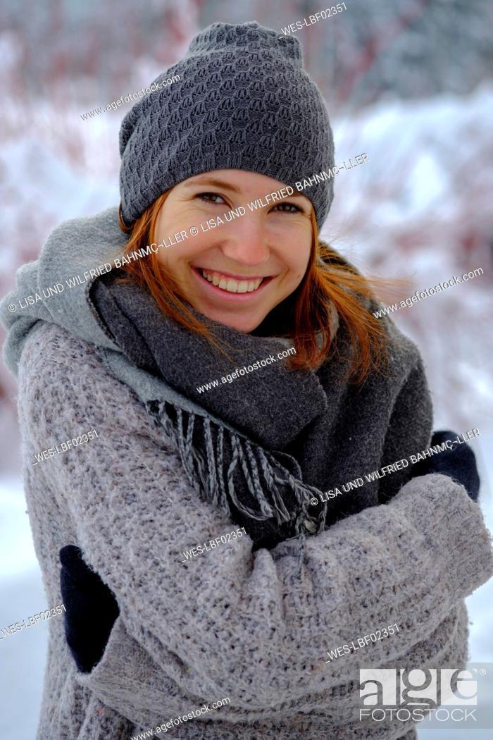 Photo de stock: Portrait of smiling teenage girl outdoors in winter.