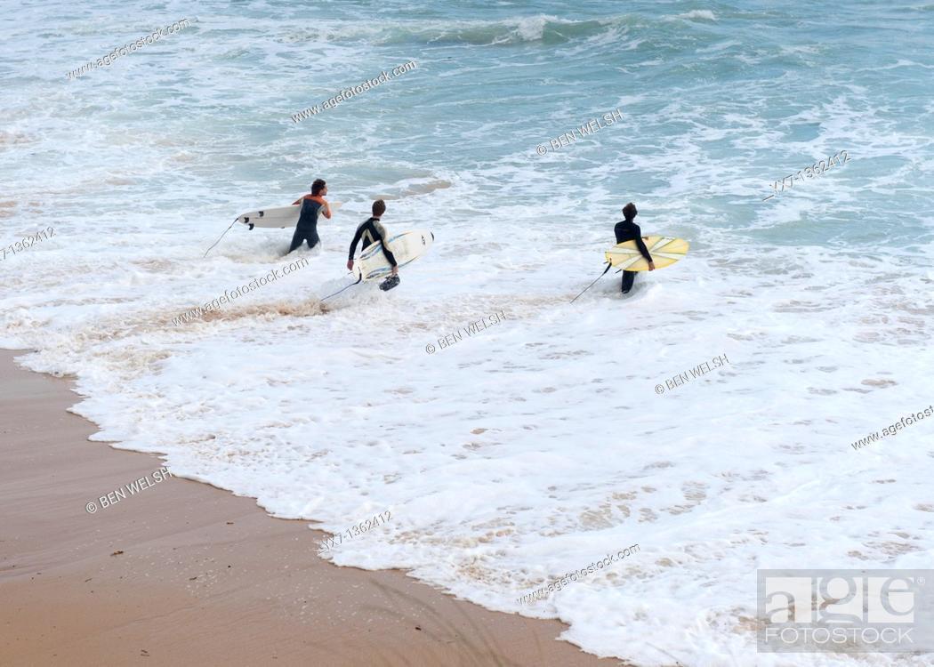 Stock Photo: Surfers, Tarifa, Costa de la Luz, Cadiz province, Andalusia, Spain.