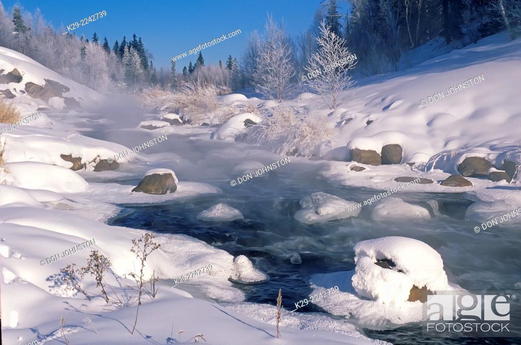 Stock Photo: Junction Creek witn open water in mid winter, Greater Sudbury, Ontario, Canada.
