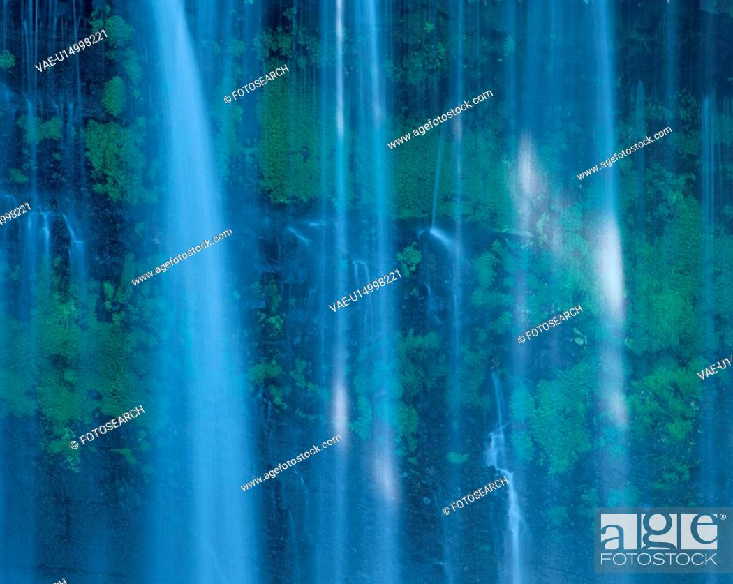 Stock Photo: Mosses Behind Falling Water.