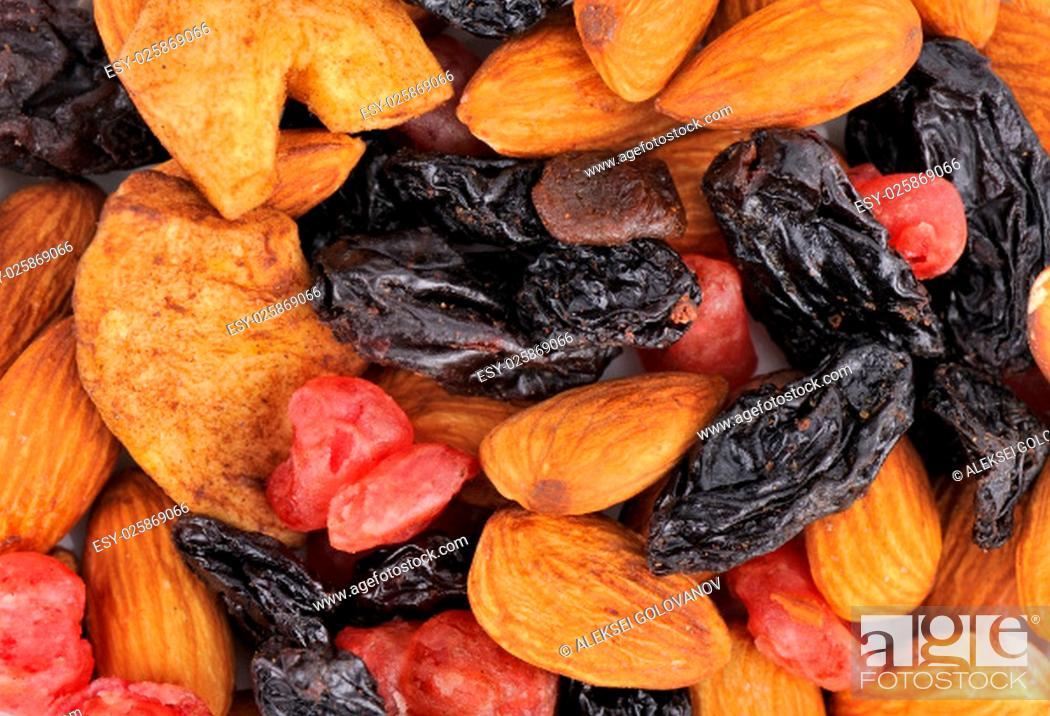 Stock Photo: Heap of Mixed Dried Fruits of apples raisins cherries almonds.