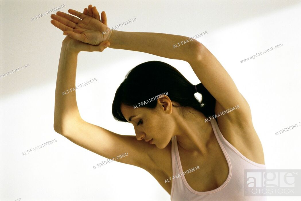 Stock Photo: Woman stretching, arms in air.