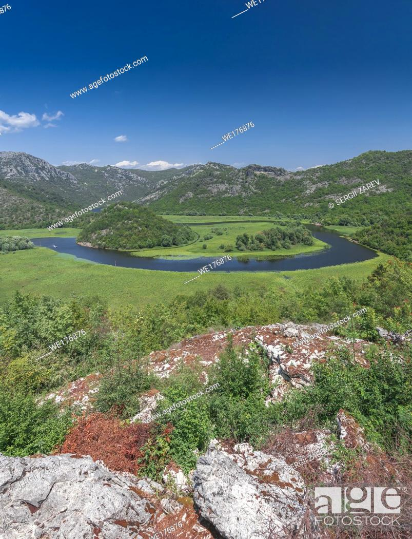 Stock Photo: Panoramic view from above of Skadar lake and Crnojevica river in a national park, Montenegro, in a sunny summer day.