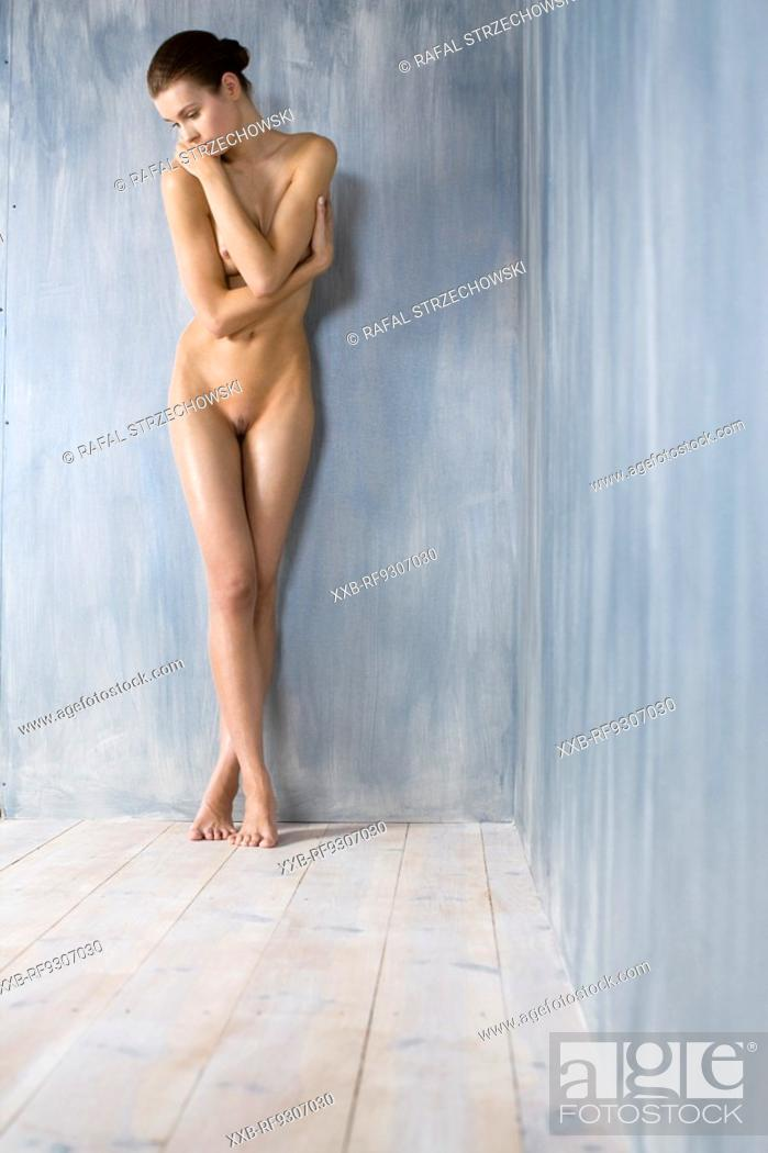 Stock Photo: nude woman covering her body.