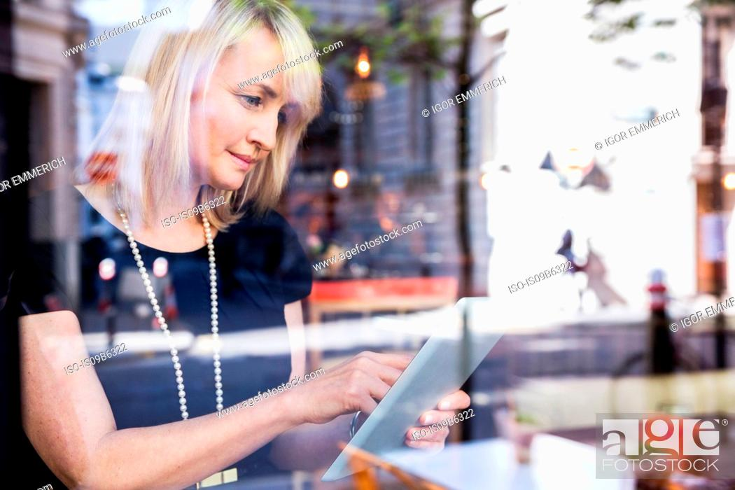 Stock Photo: Businesswoman using digital tablet.