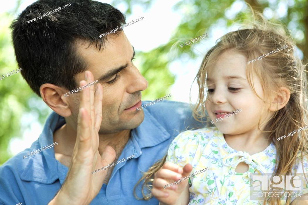 Stock Photo: Father showing daughter his hand.